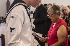 An Australian Naval Cadet makes the collection in the traditional way.